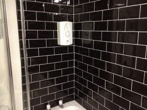 Black tiled wall after